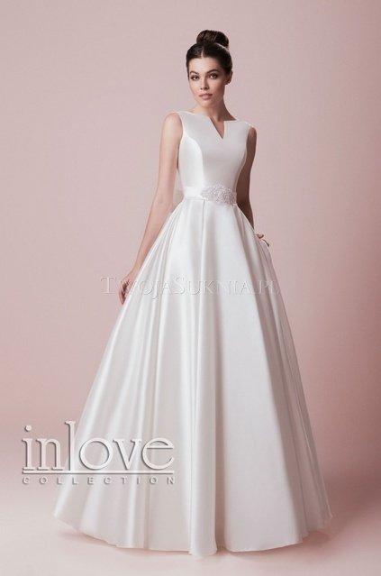 4628bb71f9 Przymierz także  prostą suknię ślubną
