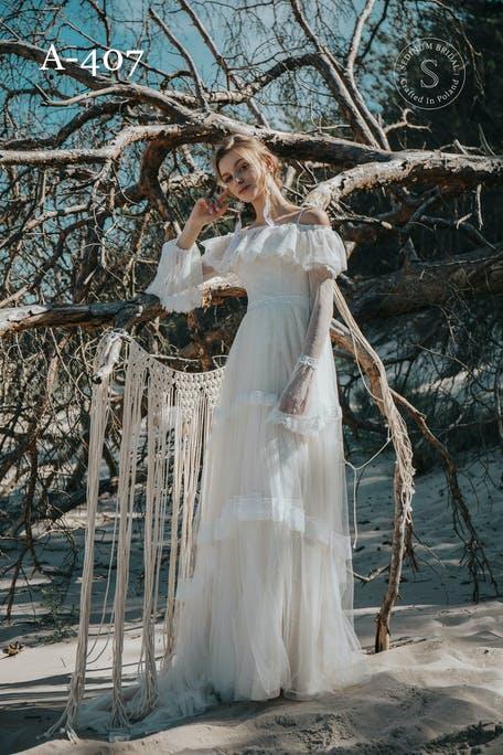 suknia ślubna w stylu boho z długim rękawem