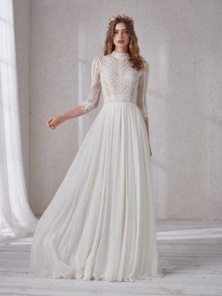 Suknie ślubne z koronkowym golfem 2020