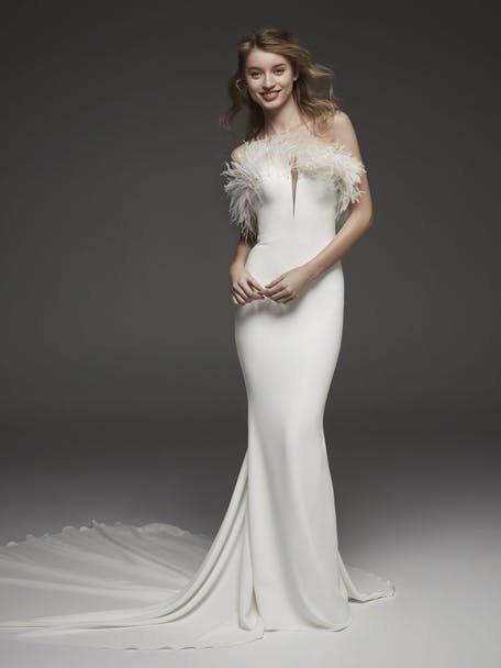 Suknie ślubne z piórami - trendy 2020